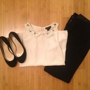 Sleeveless ivory top with jeweled collar!