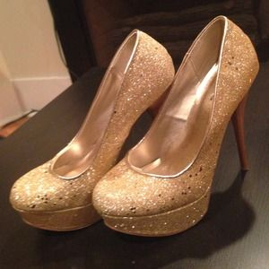Preloved gold platform heels!