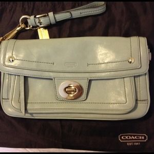 Coach legacy collection green turn lock clutch.