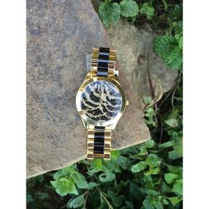 Black and gold MK watch