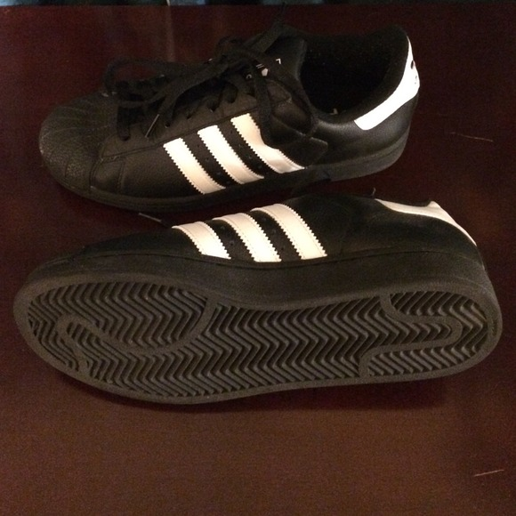 adidas black shoes with white stripes