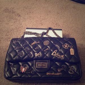 Handbags - Chanel black purse w silver hardware & charms