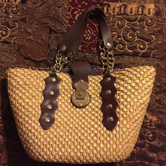 8dbf795c30d0 Michael Kors wicker purse. M_546fdcfb4107cc338d003e89
