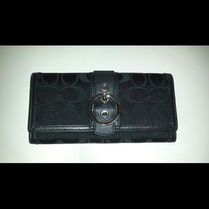Black buckled coach wallet