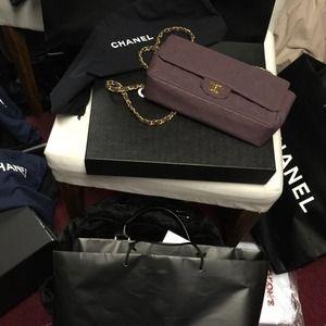 $old CHANEL flap handbag with gold hardware.