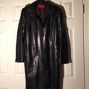 Slightly worn Cole Haan mid length leather coat.