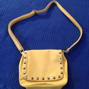 Yellow over-the-shoulder purse.