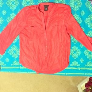 a shimmery coral button up blouse