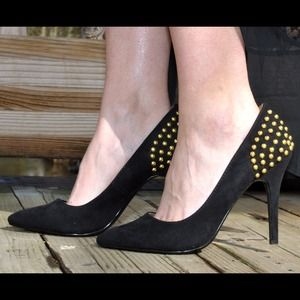 Black studded pumps