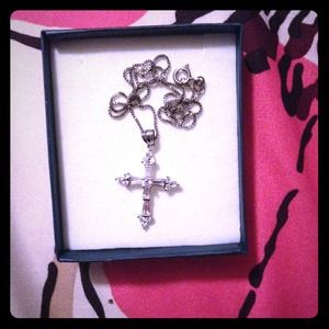 Jewelry - A sterling silver cross necklace.