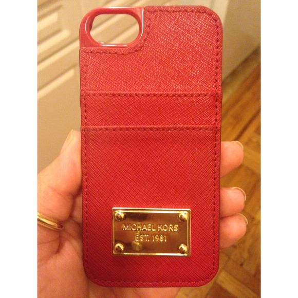 59c7101c9c59 Michael Kors Saffiano Leather Pocket Phone Case. M 547e5cbb35d2db2708382b76