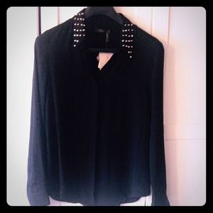 Studded black blouse.