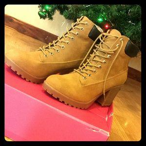 High heeled fashion construction boots!