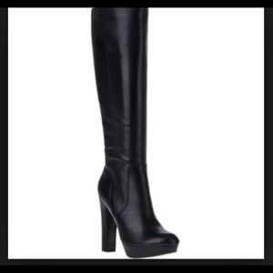 Michael Kors tall leather boots.