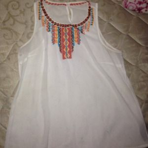 White silky top. Beads colors are blue & orange