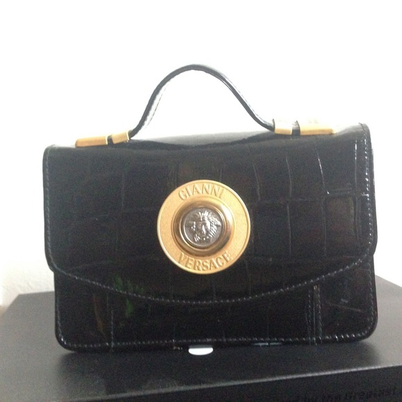 78% off Versace Clutches & Wallets