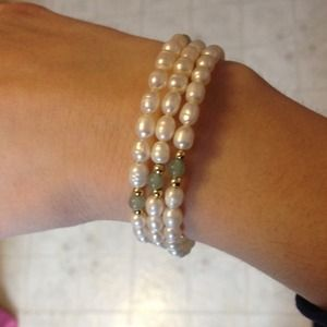 White pearls with green stones