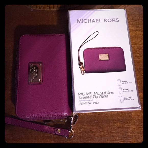 15802f7dfa2f Michael Kors Essential Zip Wallet iPhone Wristlet.  M_54977144f71a86054c02e5fe