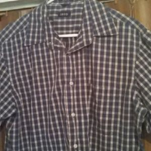 A blue and white plaid dress up shirt 100% cotton