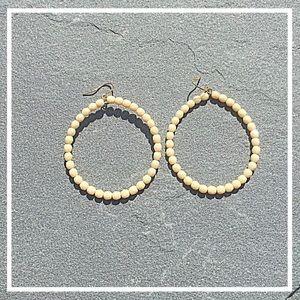 hoop earrings w beige beads