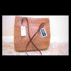 Jennifer Moore straw bag with leather stings.