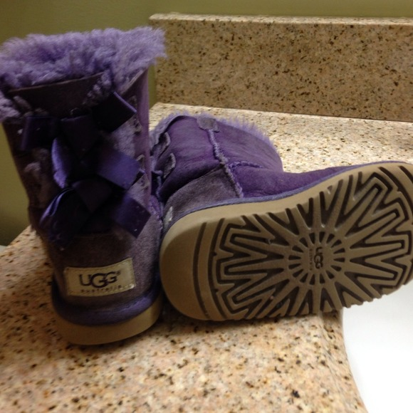 purple uggs with bows on the back