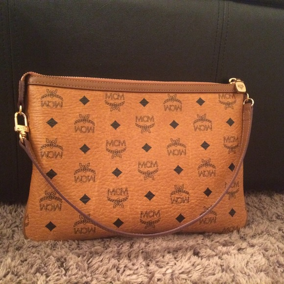 mcm one day sale mcm clutch from rachel 39 s closet on poshmark. Black Bedroom Furniture Sets. Home Design Ideas