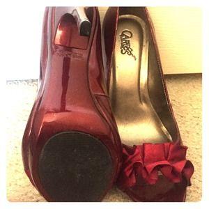 Carlos Santana oxblood peep toes.