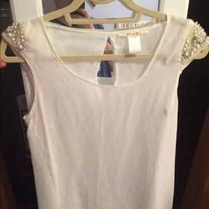 Tops - White sheer top with beaded cap sleeves.