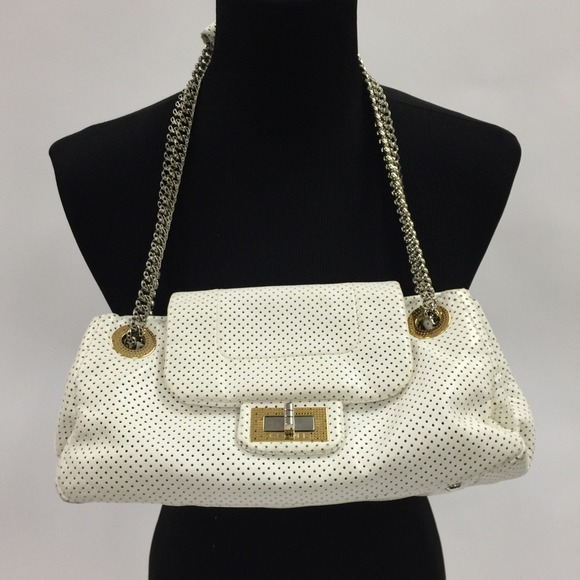 e2372769bbd7ab CHANEL Handbags - CHANEL Ivory perforated drill flap leather bag
