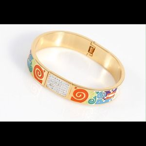 Stainless steel, 18karat gold plated bangle