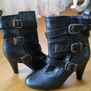 Dark brown boots with buckles