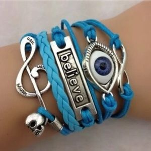 Jewelry - Gorgeous bracelet BELIEVE theme charms. Blue. New