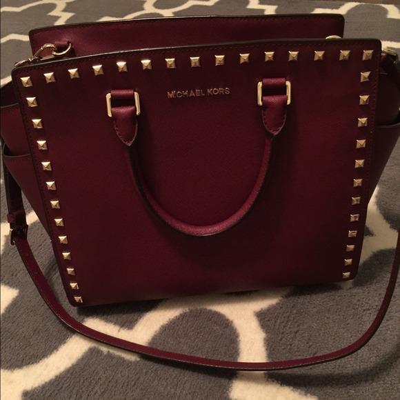 423b47554317 Michael Kors Maroon purse with gold studs. M_54ab343da632b62fa032dddb