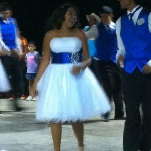 White dress with blue sash modeled