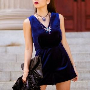 Blue velvet romper with lace detail on the back