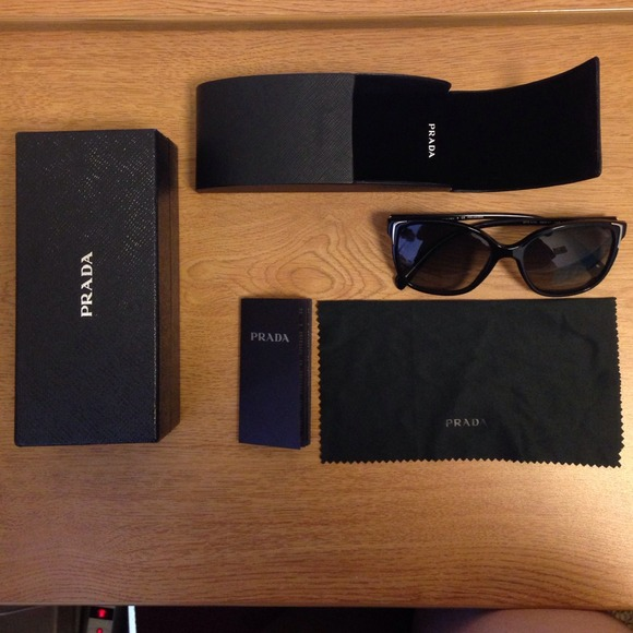 6320ed183d5 Prada Polarized PR 01OS Sunglasses. M 54ad86e535d2db7cbb3d6177. Other  Accessories ...