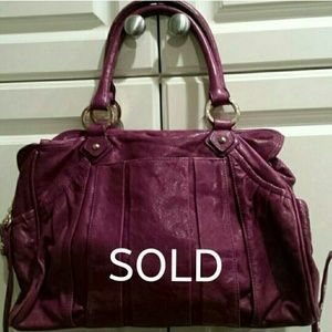 Authentic Junior Drake eggplant colored handbag