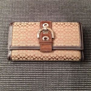 Coach® buckle wallet