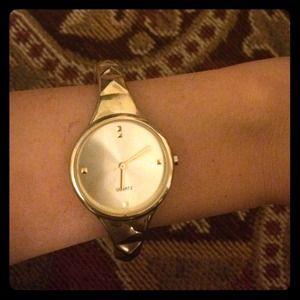 Gold bangle watch