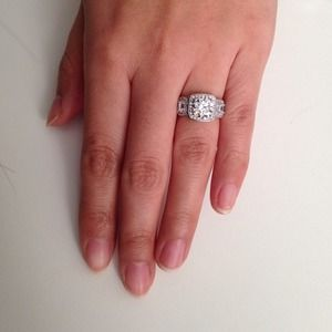 Sterling silver three stone halo engagement ring