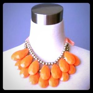 Jewelry - Jennifer Lopez boho chic bib necklace in orange.