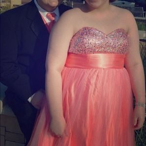 This is a coral poofy prom dress size 1x