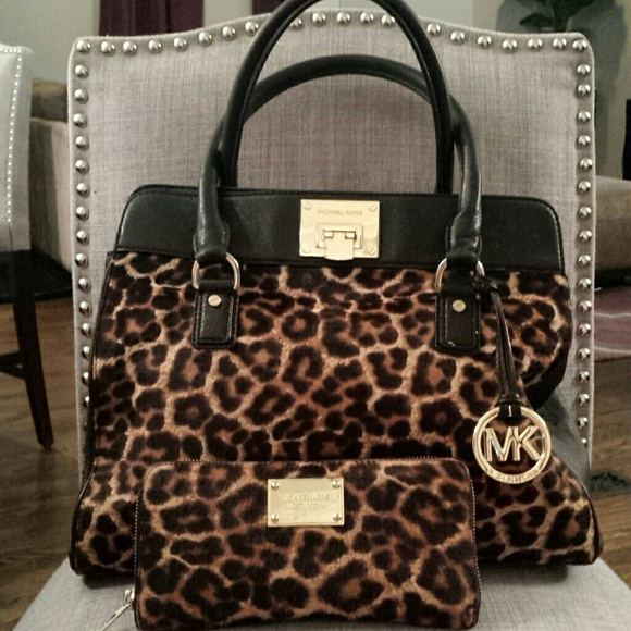 d314eb209eb Michael Kors Cheetah bag with matching wallet. M 54b72114c8ce8513400531ca