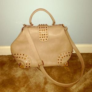 Taupe leather and gold hardware studded handbag