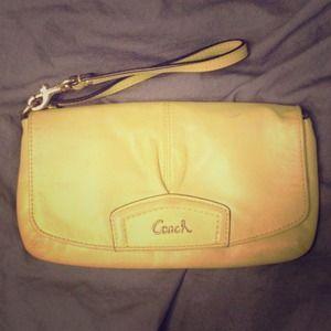 yellow-green coach wallet/wristlet.