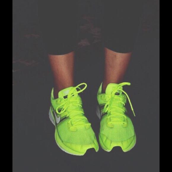 Neon yellow women's Nike tennis shoes