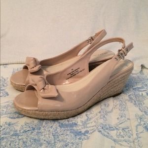 Nude, casual wedges that are 1 1/2 inches tall.