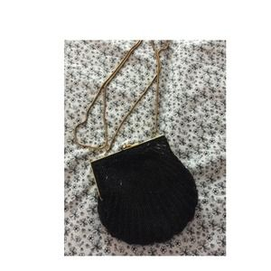 Carla marchi black purse with golden strap.