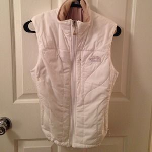 White North Face vest with beige lining.